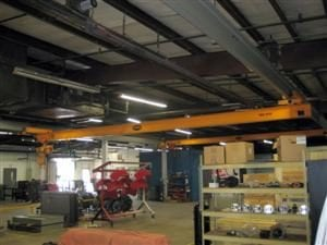 Underhung single girder bridge crane with coped girder